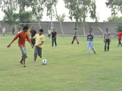 Boys Enjoying a Soccer Game in Machike Boarding School