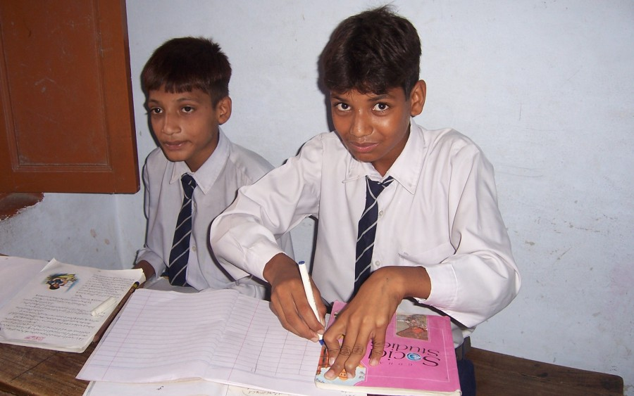 Boys in Martinpur Day School Busy Doing Their Class-work