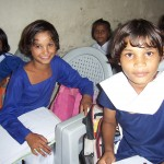 Girls Don't Mind Taking a Break From Learning For a Picture