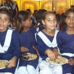 Girls Enjoying a Rice Meal